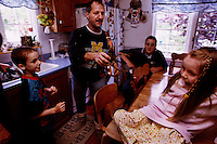 Kurt with Lobster and Family..But being a former fisherman, Kurt has no choice, he wants to provide for his family, so he is willing to take risks on the platform that other former fishermen would never consider. (Kurt is also shown in photo on Hibernia where he is a deck hand)...