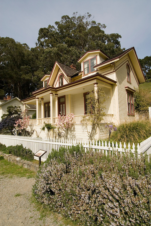 Restored officer's house at Camp Reynolds, Angel Island State Park, in San Francisco Bay, CA, California.  People disembark and picnic at Ayala Cove, then hike, bike, or tram perimeter road, with stops at Civil War era Camp Reynolds, and its restored officer house, or Spanish American War era Fort McDowell..Photo camari248-70578..Photo copyright Lee Foster, www.fostertravel.com, 510-549-2202, lee@fostertravel.com.