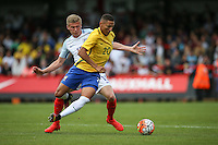 Richarlison of Brazil & Taylor Moore (Bristol City) of England during the International match between England U20 and Brazil U20 at the Aggborough Stadium, Kidderminster, England on 4 September 2016. Photo by Andy Rowland / PRiME Media Images.