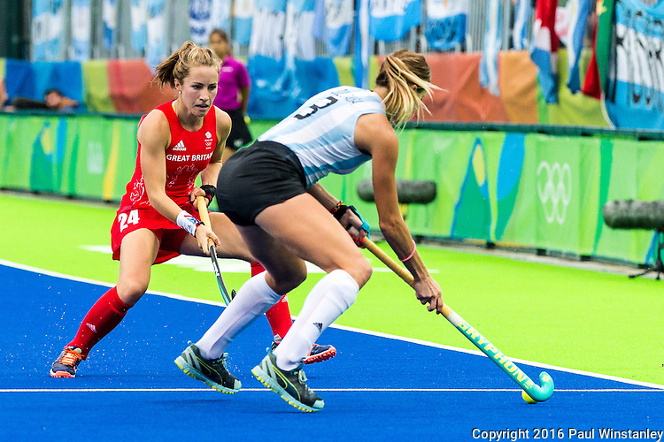 Joie Leigh #14 of Great Britain closes in on Victoria Zuloaga #3 of Argentina during Argentina vs Great Britain in women's Pool B game  at the Rio 2016 Olympics at the Olympic Hockey Centre in Rio de Janeiro, Brazil.