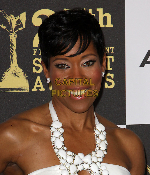 REGINA KING .25th Annual Film Independent Spirit Awards held At The Nokia LA Live, Los Angeles, California, USA,.March 5th, 2010 ..arrivals Indie Spirit portrait headshot white halterneck cut out  embellished earrings smiling .CAP/ADM/KB.©Kevan Brooks/Admedia/Capital Pictures