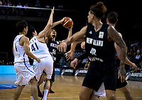 Korea's Sekeun Oh tries to block New Zealand's Shea Ili during the FIBA World Cup qualifier between the New Zealand Tall Blacks and South Korea at TSB Bank Arena in Wellington, New Zealand on Thursday, 23 November 2017. Photo: Dave Lintott / lintottphoto.co.nz