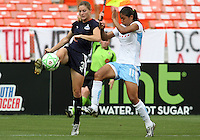 Jill Gilbeau #3 of Washington Freedom sends over a pass in front Cristine Silva #11 of Chicago Red Stars during a WPS match at RFK Stadium on June 13 2009, in Washington D.C.
