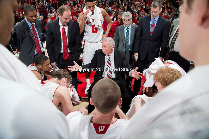 Wisconsin Badgers Head Coach Bo Ryan talks to his players during timeout during a Big Ten Conference NCAA college basketball game against the Michigan Wolverines Saturday, February 9, 2013, in Madison, Wis. The Badgers won 65-62 (OT). (Photo by David Stluka)