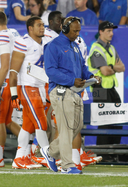 Florida wide reciever coach Joke Phillips during the first half of the UK football game against Florida at Commonwealth Stadium in Lexington, Ky., on Saturday, September 28, 2013. Photo by Eleanor Hasken | Staff