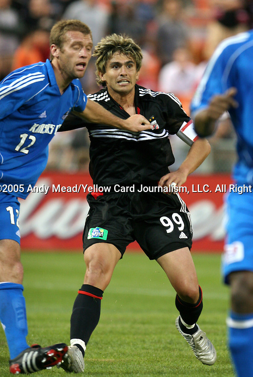 21 May 2005: Jimmy Conrad (12) holds onto Jaime Moreno (99). DC United defeated the Kansas City Wizards 3-2 at RFK Stadium in Washington, DC in a regular season Major League Soccer game. . .
