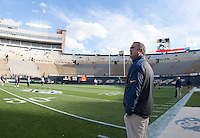 California head coach Sonny Dykes is pictured on the field before the game against Colorado at Folsom Field in Boulder, Colorado on November 16th, 2013.  Colorado defeated California, 41-24.