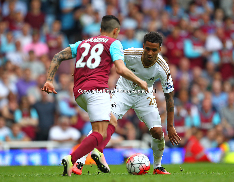 Manuel Lanzini of West Ham United and Kyle Naughton of Swansea   during the Barclays Premier League match between West Ham United and Swansea City  played at Boleyn Ground , London on 7th May 2016