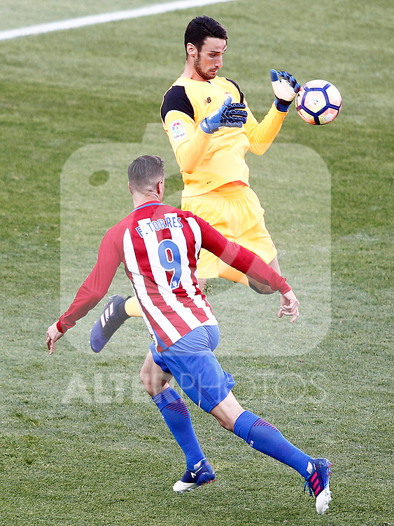 Atletico de Madrid's Fernando Torres (l) and Sevilla FC's Sergio Rico during La Liga match. March 19,2017. (ALTERPHOTOS/Acero)