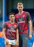 Alexis Sanchez of Arsenal & Per Mertesacker of Arsenal after the match during the Premier League match between Chelsea and Arsenal at Stamford Bridge, London, England on 17 September 2017. Photo by Andy Rowland.