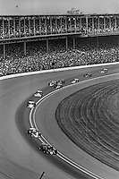 INDIANAPOLIS, IN - MAY 28: Danny Ongais, driving the Parnelli VPJ6B/VPJ Cosworth, leads a group of cars through Turn 1 during the Indy 500 at the Indianapolis Motor Speedway in Indianapolis, Indiana, on May 28, 1978.