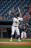 Akron RubberDucks Ka'ai Tom (4) at bat during an Eastern League game against the Reading Fightin Phils on June 4, 2019 at Canal Park in Akron, Ohio.  Akron defeated Reading 8-5.  (Mike Janes/Four Seam Images)