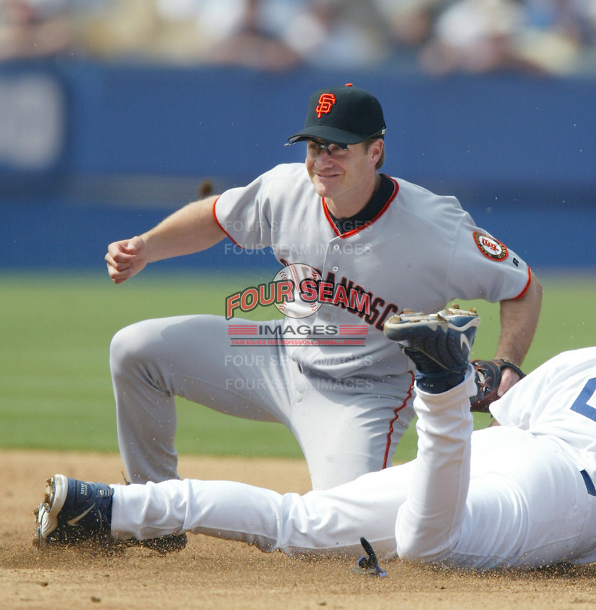 David Bell of the San Francisco Giants tags a sliding runner during a 2002 MLB season game against the Los Angeles Dodgers at Dodger Stadium, in Los Angeles, California. (Larry Goren/Four Seam Images)