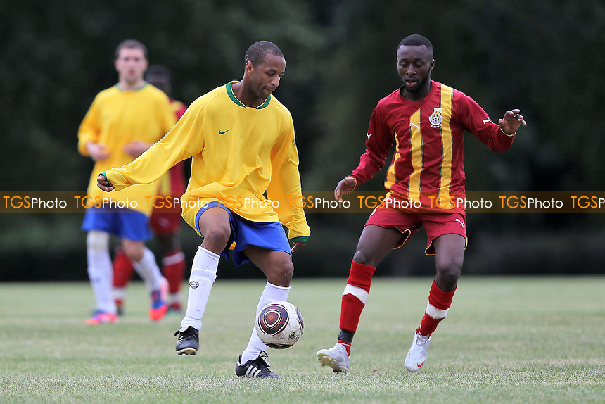 Black Meteors (red/yellow) vs Albion Manor - Hackney & Leyton Sunday League Football at South Marsh, Hackney Marshes, London - 16/09/12 - MANDATORY CREDIT: Gavin Ellis/TGSPHOTO - Self billing applies where appropriate - 0845 094 6026 - contact@tgsphoto.co.uk - NO UNPAID USE.