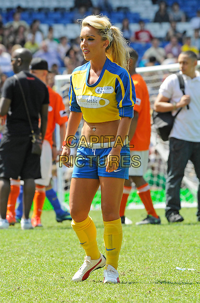 GUEST.Celebrity Soccer Six in aid of The Samaritans held at Chelsea Football ground, Stamford Bridge, London, England..May 24th 2009 .football match game full length blue top yellow belly stomach midriff socks  .CAP/FIN.©Steve Finn/Capital Pictures.