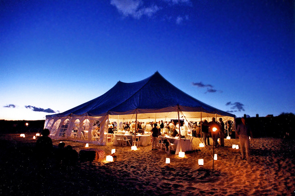 Spectacular view of tent at sunset illuminated with paper lanterns at a beach party in East Hampton.