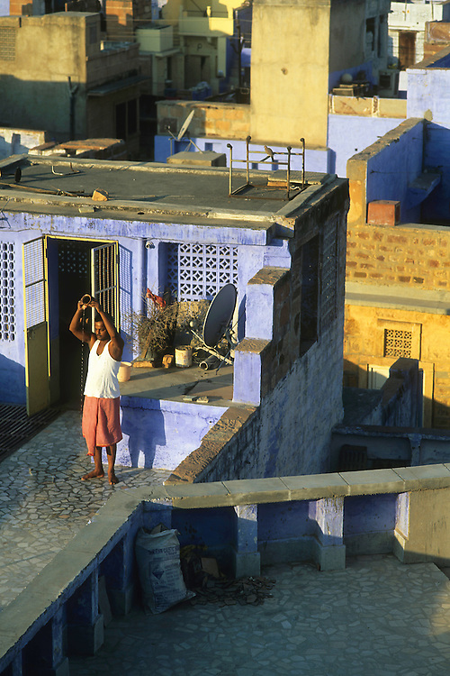 Morning ritual on a rooftop, Jodhpur, Rajasthan, India, 2011
