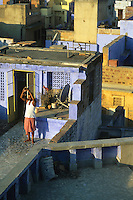 Morning ritual on a rooftop, Jodhpur, Rajasthan, India, 2011