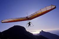 Hang-glider over Rio de Janeiro mountains in a sunny day, Brazil.