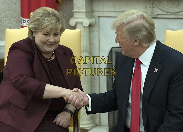 United States President Donald J. Trump, right, shakes hands with Prime Minister Erna Solberg of Norway, left, in the Oval Office of the White House in Washington, DC on Wednesday, January 10, 2018.<br /> CAP/MPI/RS<br /> &copy;RS/MPI/Capital Pictures