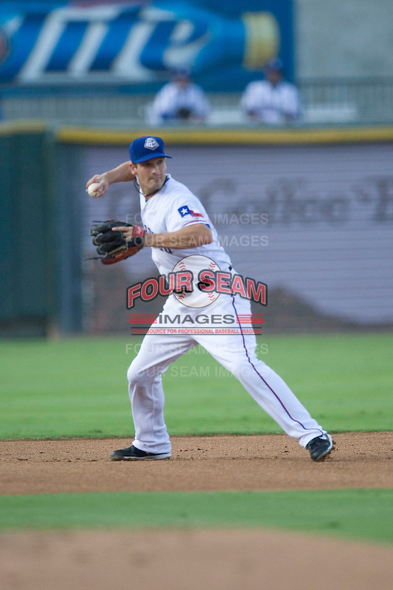 Round Rock Express shortstop Nick Green #9 throws the ball to first base during a game against the New Orleans Zephyrs at the Dell Diamond on July 21, 2011 in Round Rock, Texas.  New Orleans defeated Round Rock 7-4.  (Andrew Woolley/Four Seam Images)