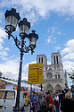Paris, France. 09.05.2015. Tourists on front of Notre Dame Cathedral. Photograph © Jane Hobson.