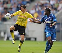 FUSSBALL   1. BUNDESLIGA  SAISON 2011/2012   2. Spieltag   13.08.2011 TSG 1899 Hoffenheim - Borussia Dortmund  Robert Lewandowski (li, Borussia Dortmund) gegen Isaac Vorsah (TSG 1899 Hoffenheim)