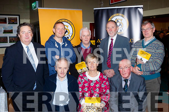 Seated, L-R Tim Slattery, Adrainne McLoughlin and Martin Collins, back L-R Eddie Barrett, Seamus Smith, Tadgh McMahon, Billy Ryle and Tony O'Keeffe who were all involved in the creation of the book, 100 yrs history of the Stacks GAA, last Friday night in the Stacks clubhouse, Connolly Park, Tralee.