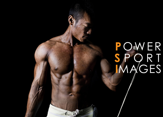 A bodybuilder poses for a photograph behind the scenes of the 2016 Hong Kong Bodybuilding Championships on 12 June 2016 at Queen Elizabeth Stadium, Hong Kong, China. Photo by Victor Fraile / Power Sport Images
