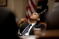 President Barack Obama leans back in his chair as he listens to the discussion at a Long-Term Fiscal meeting in the Roosevelt Room of the White House, May 29, 2009. (Official White House Photo by Pete Souza)<br /> <br /> This official White House photograph is being made available for publication by news organizations and/or for personal use printing by the subject(s) of the photograph. The photograph may not be manipulated in any way or used in materials, advertisements, products, or promotions that in any way suggest approval or endorsement of the President, the First Family, or the White House.