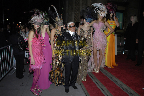 ROBERTO CAVALLI (dressed as designer Karl Lagerfeld).Roberto Cavalli Vodka and Giuseppe Cipriani Halloween party at Cirpiani 42nd Street to benefit Children in Crisis and The Happy Hearts Fund, New York, New York, USA..October 31st 2007.full length dress up costume fingerless gloves rings collar white black jacket sunglasses shades tie pink orange feathers dress mask.CAP/ADM/BL.©Bill Lyons/AdMedia/Capital Pictures. *** Local Caption ***