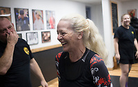 """Susa Johnson of McCalister, Okla. laughs as she takes a break practicing silat self-defense maneuvers, Saturday, June 20, 2020 at Integrated Combat Systems NWA in Fayetteville. Instructors provided a four hour silat seminar for combat enthusiasts and people interested in self-defense. Silat is an Indonesian form of martial arts involving empty hand combat, grappling and bladed fighting. """"Unlike other martial arts, everything is trained concurrently. You apply the same concepts with empty hands as with weapons. It's a more streamlined process of learning how to fight and defend yourself,"""" said Diem Ngu, owner and instructor. Check out nwaonline.com/200621Daily/ for today's photo gallery. <br /> (NWA Democrat-Gazette/Charlie Kaijo)"""