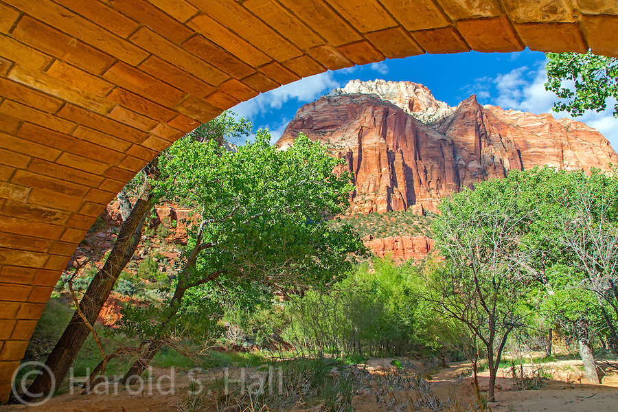 The bridge at Pine Creek in Zion National Park Utah frames the near by mountain peaks.  This bridge was build by the Civilian Conservation Corps in the 1930's.