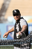 Chicago White Sox Manager Robin Ventura #23 throws batting practice before a game against the Los Angeles Dodgers at Dodger Stadium on June 15, 2012 in Los Angeles, California. Los Angeles defeated Chicago 7-6. (Larry Goren/Four Seam Images)