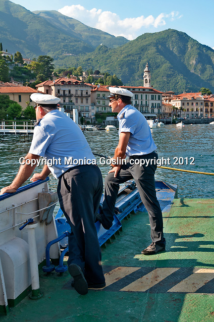 Ferry boat sailors admire the view of Menaggio on Lake Como, Italy