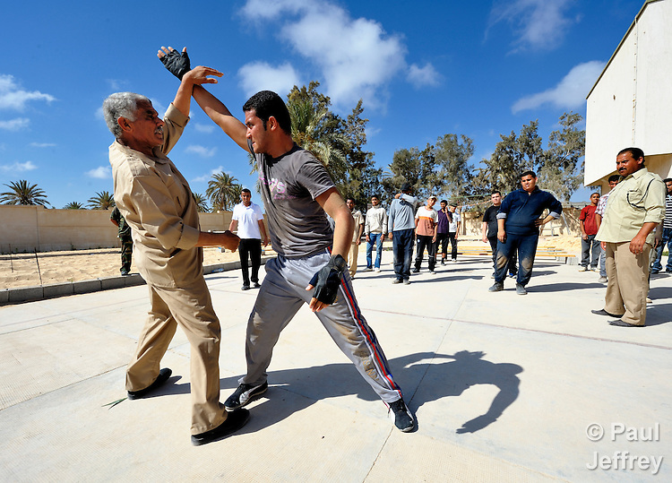 Libyan rebels have suffered heavy losses on the battlefield in their war against strongman Moammar Gadhafi, so replacements are needed. At a training center in the rebel enclave of Misrata, recruits go through a 20-day training program to prepare them for the frontline. The training includes hand to hand combat training by instructor Al-Taher Shaba (left).