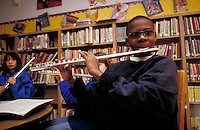 ELEMENTARY SCHOOL BAND PRACTICE  - BOY PLAYING FLUTE. ELEMENTARY SCHOOL STUDENTS. OAKLAND CALIFORNIA USA CARL MUNCK ELEMENTARY SCHOOL.