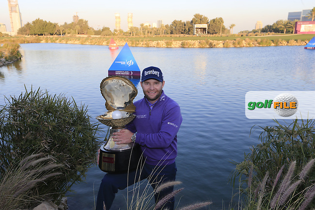 Branden Grace (RSA) wins the tournament by 2 shots and successfully defends his title at the end of Saturday's Final Round of the 2016 Commercial Bank Qatar Masters held at the Doha Golf Club, Doha, Qatar. 30th January 2016.<br /> Picture: Eoin Clarke | Golffile<br /> <br /> <br /> All photos usage must carry mandatory copyright credit (&copy; Golffile | Eoin Clarke)