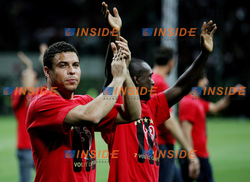 AC Milan forward Ronaldo (front) and his team-mate Clarence Seedorf celebrate their Champions League at the San Siro stadium in Milan, 25 may 2007. AC Milan beat Liverpool 2-1 in the final match of the Champions League last Tuesday. Insidefoto / Paco SERINELLI