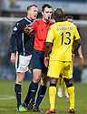 Referee Don Robertson steps in to separate Dundee's David Clarkson and St Mirren's Issac Osbourne as tempers flare.
