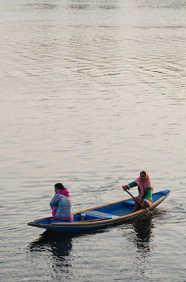 Traditional Kashmiri shikaras, or gondolas, at sunset, Dal Lake, Srinagar, Kashmir, india.