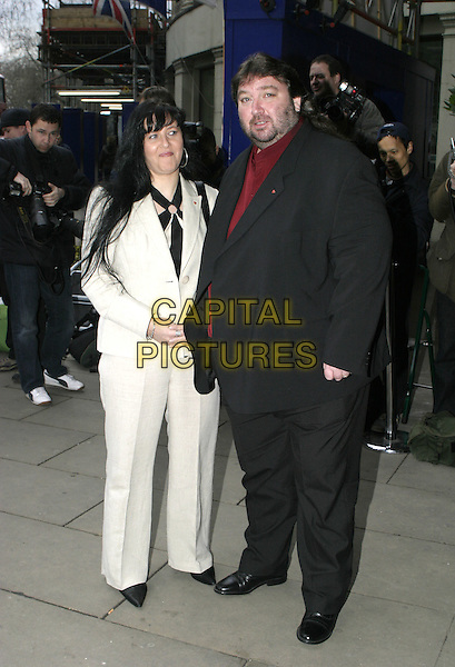 ANDY FORDHAM & GUEST.TRIC Awards - Television & Radio Industries Club at the Grosvenor House, Park Lane..March 8th, 2005.full length beard facial hair black suit white suit.www.capitalpictures.com.sales@capitalpictures.com.© Capital Pictures.
