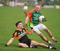 26-10-2014:Darran O'Sullivan,  Mid Kerry, breaks away from Pat McCarthy, Austin Stacks,  in the Kerry senior football County Championship final at Austin Stack Park, Tralee on Sunday.  Picture: Don MacMonagle