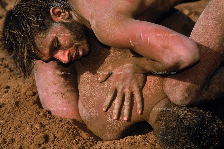 Wrestlers near Sahiwal, Pakistan. 4,800 years ago, at the same time as the early civilizations of Mesopotamia and Egypt, great cities arose along the flood plains of the Indus and Saraswati (Ghaggar-Hakra) rivers.  Developments at Harappa have pushed the dates back 200 years for this civilization, proving once and for all, that this civilization was not just an offshoot of Mesopotamia..They were a highly organized and very successful civilization.  They built some of the world's first planned cities, created one of the world's first written languages and thrived in an area twice as large as Egypt or Mesopotamia for 900 years (1500 settlements spread over 280,000 square miles on the subcontinent)..There are three major communities--Harappa, Mohenjo Daro, and Dholavira. The town of Harappa flourished during this period because of it's location at the convergence of several trade routes that spanned a 1040 KM swath from the northern mountains to the coast.
