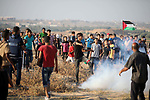 Palestinian protesters clash with Israeli troops following the tents protest where Palestinians demand the right to return to their homeland at the Israel-Gaza border, in the central of Gaza Strip, July 26, 2019. Photo by Stringer