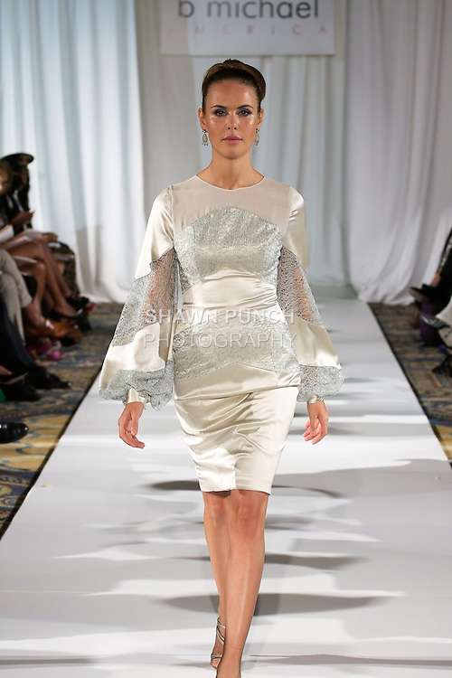 Model walks runway in an outfit from the b Michael AMERICA Couture Spring 2013 collection during Mercedes-Benz Fashion Week Spring 2013, at the Jumeirah Essex House on September 12, 2012.
