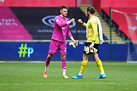 Freddie Woodman of Swansea City shakes hands with Joe Wildsmith of Sheffield Wednesday during the Sky Bet Championship match between Swansea City and Sheffield Wednesday at the Liberty Stadium in Swansea, Wales, UK. Sunday 05 July 2020