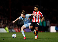 11th February 2020; Griffin Park, London, England; English Championship Football, Brentford FC versus Leeds United; Luke Ayling of Leeds United challenges Ollie Watkins of Brentford