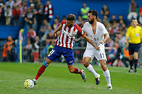 Atletico Madrid´s Carrasco and Real Madrid Arbeloa