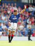 Ally McCoist waves to the fans as the 1994 season gets underway at Ibrox Stadium with a friendly match against Manchester Utd